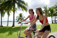 Two women on bicycles, side by side - Alex Microstock02