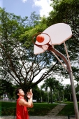 Man shooting basketball through a hoop - Alex Microstock02