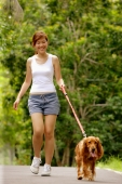 Young woman walking with her dog - Alex Microstock02