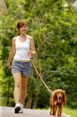 Young woman walking her dog - Alex Microstock02