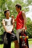 Two guys standing with skateboards - Alex Microstock02