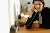Executive sitting at desk, on the phone - Alex Microstock02