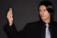 Executive holding mobile phone, photo messaging - Alex Microstock02