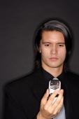 Executive holding mobile phone, portrait - Alex Microstock02