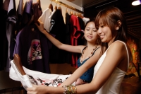 Young women looking at clothes in shop - Alex Microstock02