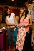 Two women at shop, looking at clothes - Alex Microstock02