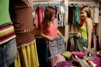 Two young women at shop, looking at clothes - Alex Microstock02