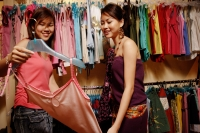 Two young women looking at clothes - Alex Microstock02