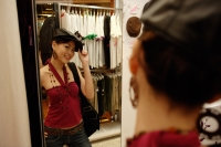 Young woman trying on beret in shop - Alex Microstock02