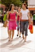 Young women walking side by side, carrying shopping bags - Alex Microstock02