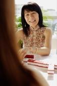 Woman playing mahjong, portrait - Alex Microstock02