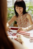 Two women playing mahjong - Alex Microstock02