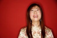 Mature woman in cheongsam, laughing - Alex Microstock02