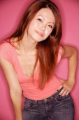 Young woman, hand on hip, bending forward - Alex Microstock02