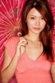 Young woman, looking at camera, holding umbrella - Alex Microstock02