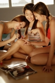 Young women applying nail polish - Alex Microstock02