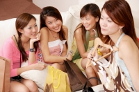 Young women sitting together with shopping bags and clothes - Alex Microstock02