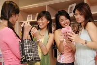 Young women at clothing store, shopping - Alex Microstock02