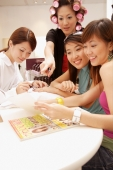 Young women getting manicure at a beauty salon - Alex Microstock02