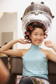 Young woman at beauty salon, hands raised - Alex Microstock02