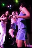 Young men and women dancing at night club - Alex Microstock02