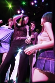 Young men and women dancing at night club, low angle view - Alex Microstock02