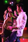 Young couple dancing at night club - Alex Microstock02