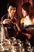Couple having drinks at night club - Alex Microstock02