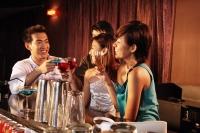 Couples having drinks at bar - Alex Microstock02