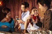 Men and women having drinks at bar - Alex Microstock02