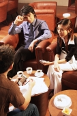 Young executives having a meeting over coffee - Alex Microstock02