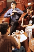 Young executives having a discussion over coffee - Alex Microstock02
