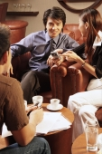 Young executives having a meeting in a cafe - Alex Microstock02