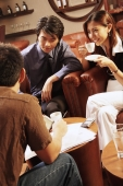 Young executives having a meeting in a cafe, woman drinking coffee - Alex Microstock02