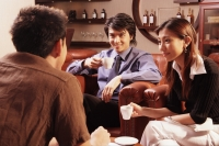 Couple having coffee, facing another man - Alex Microstock02