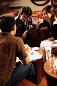 Young executives having a meeting in a cafe, woman holding cup - Alex Microstock02