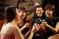 Friends in entertainment club, toasting with drinks - Alex Microstock02