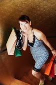 Young woman with shopping bags, climbing stairs - Alex Microstock02