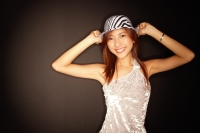 Young woman with hat, hands on head - Alex Microstock02