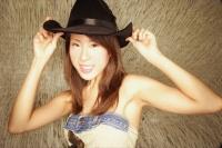 Young woman wearing cowboy hat, looking at camera - Alex Microstock02