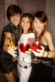 Young women raising drinks, looking at camera - Alex Microstock02