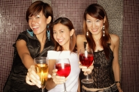 Young women holding drinks, looking at camera - Alex Microstock02