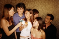 Young adults holding drinks, smiling and talking - Alex Microstock02