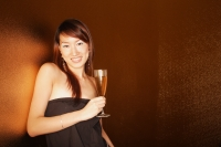 Young woman holding champagne glass, looking at camera - Alex Microstock02