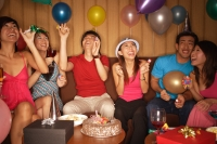 Young adults celebrating, looking up at balloons - Alex Microstock02