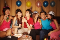 Young adults sitting side by side, celebrating - Alex Microstock02