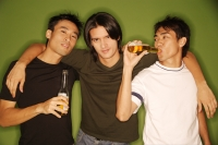 Three young men, arm around each other, facing camera - Alex Microstock02