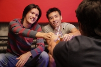 Young men toasting with beer bottles, face to face - Alex Microstock02