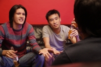 Young men with beer bottles, bonding - Alex Microstock02