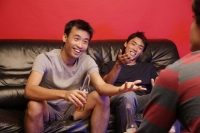 Young men sitting on sofa, with beer bottles - Alex Microstock02